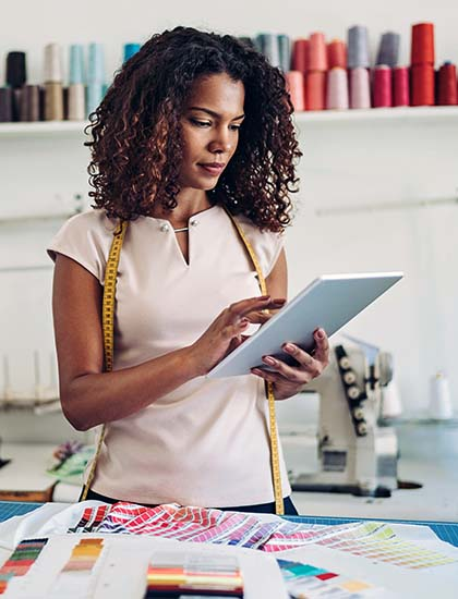 business owner managing finances on phone