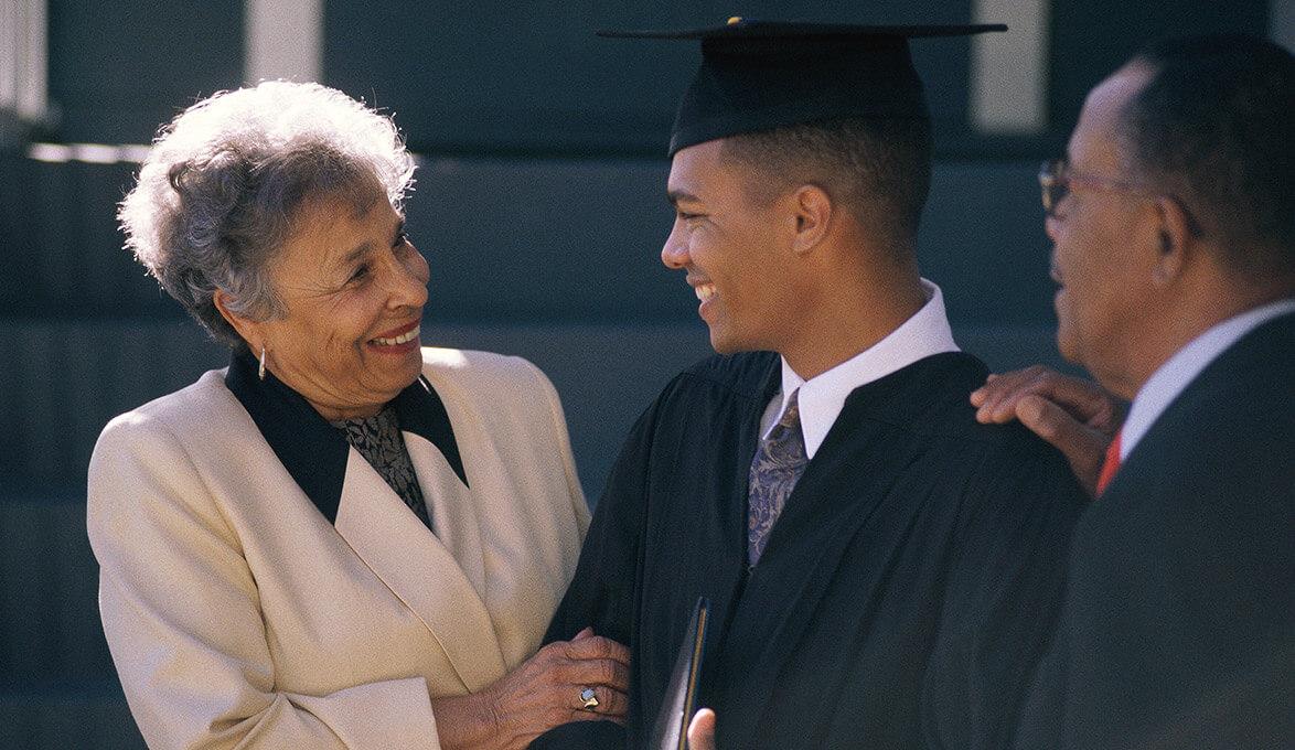 proud parents with college graduate son