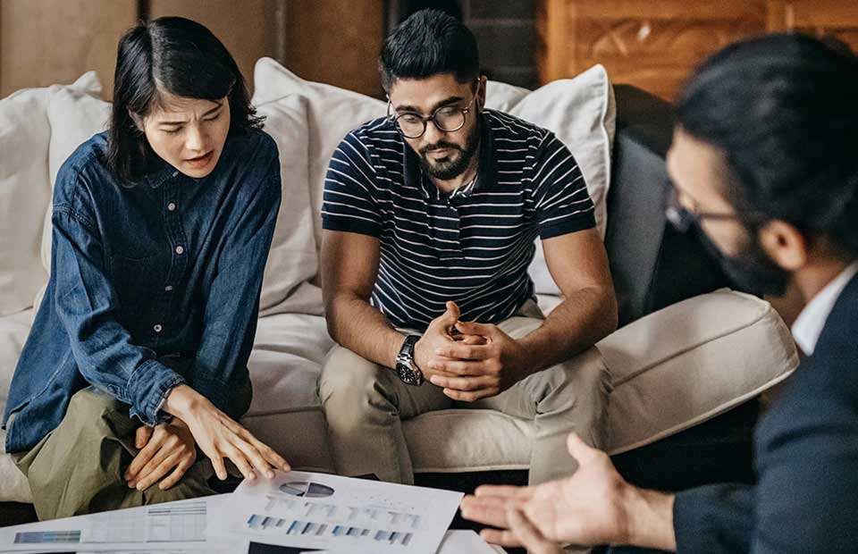 couple meeting with financial advisor for an annual review
